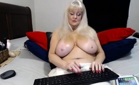 curvy-blonde-cougar-with-big-hooters-fucks-herself-on-webcam