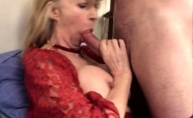 bodacious-blonde-cougar-has-a-young-stud-banging-her-holes