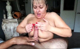 naughty-mature-lady-with-huge-natural-breasts-blows-a-cock