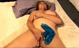 voluptuous-mature-wife-brings-herself-to-climax-on-the-bed