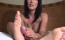 sensual-brunette-mom-with-sexy-feet-gives-a-nice-pov-handjob