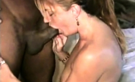 stacked-blonde-milf-offers-a-hung-black-guy-a-deep-blowjob