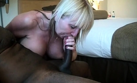 voluptuous-mature-blonde-works-her-sexy-lips-on-a-black-pole