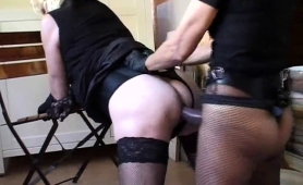 crossdresser-in-lingerie-gets-fucked-with-a-strap-on-toy