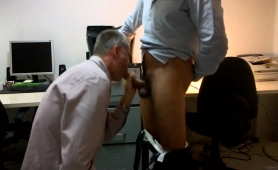 Horny daddy delivers a wonderful blowjob in the office
